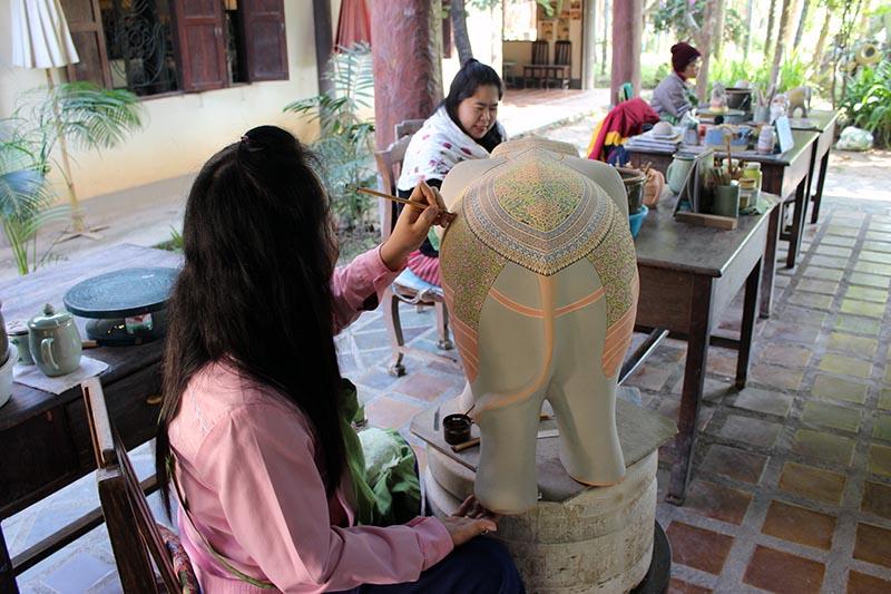 Overglaze painting a large elephant.